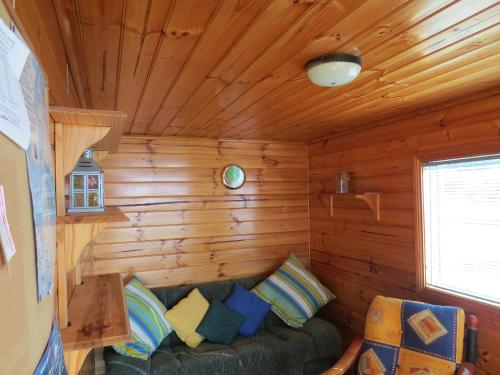 A bed or beds in a room at Captain Cook Holiday Park