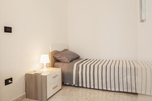 Letto o letti in una camera di San Nicola Trilocali VGM