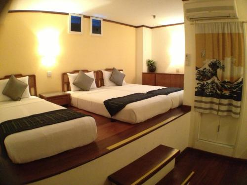 A bed or beds in a room at Perak Hotel (SG Clean, Staycation Approved)