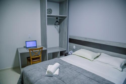 A bed or beds in a room at Hotel Prime Executive