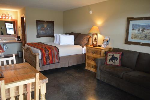 A bed or beds in a room at NRS Event Center & Guest Ranch