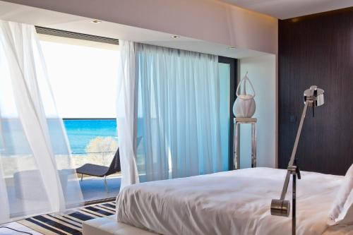 Krevet ili kreveti u jedinici u okviru objekta Aqua Blu Boutique Hotel & Spa, Adults Only- Small Luxury Hotels of the World