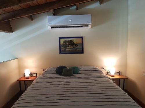 A bed or beds in a room at Anaté Beach Apartments, Mangel Alto