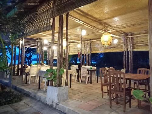 A restaurant or other place to eat at Sand Beach Bungalow