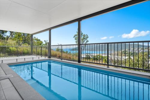 The swimming pool at or near Seaviews ! Pool, BBQ, Luxury home in Airlie Beach Central