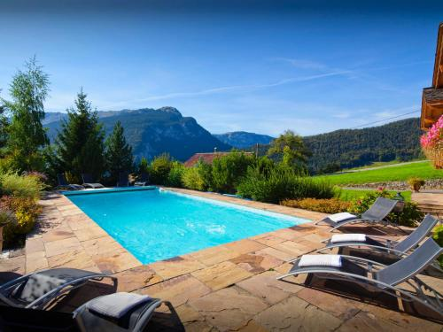 The swimming pool at or near Chalet Beauvoir 4 - OVO Network