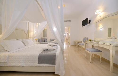 A bed or beds in a room at Kamari Hotel