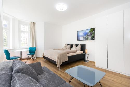 A bed or beds in a room at INNSBRUCK CITY APARTMENTS *****