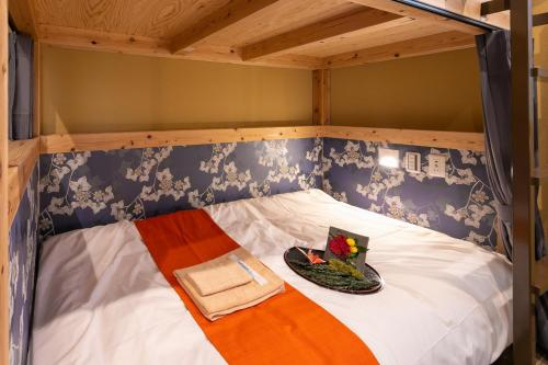 A bed or beds in a room at IKIDANE Cozy Hotel Haneda Airport