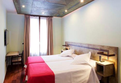 A bed or beds in a room at Hotel Posada De La Luna
