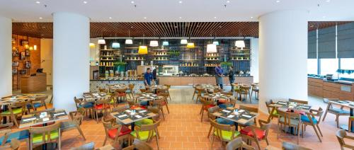 A restaurant or other place to eat at Hilton Garden Inn Kuala Lumpur - South