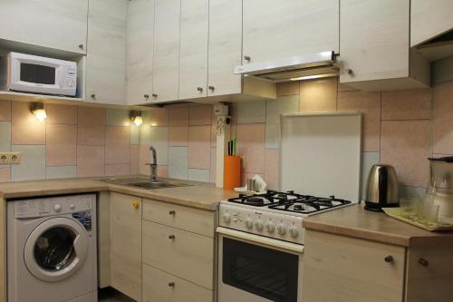 Кухня или мини-кухня в Aurelia Hotel