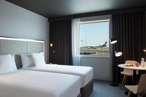 Cama ou camas em um quarto em Innside by Melia Paris Charles de Gaulle Airport