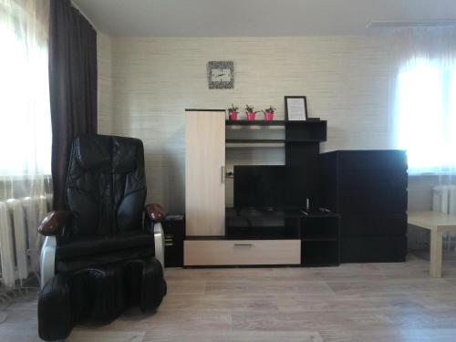 A television and/or entertainment center at Apartment in Prospekt Stroiteley