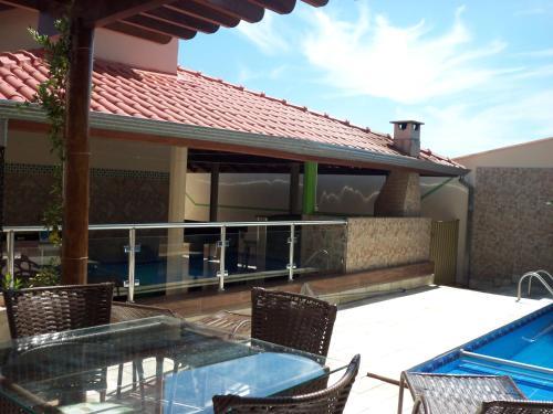 A piscina localizada em Casa Temporada Daniel- Olímpia SP ou nos arredores