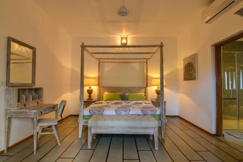 A bed or beds in a room at Niketh Villa