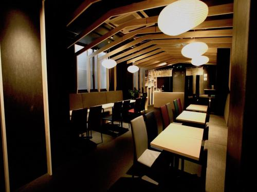 A restaurant or other place to eat at Qoo Hostel Osaka