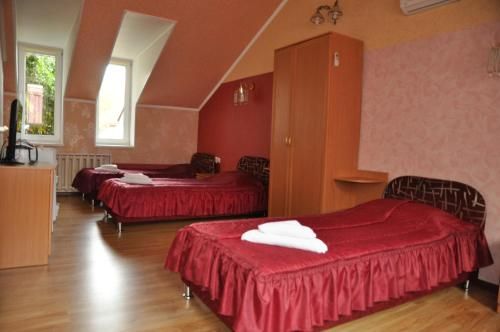 A bed or beds in a room at Hotel Uyut
