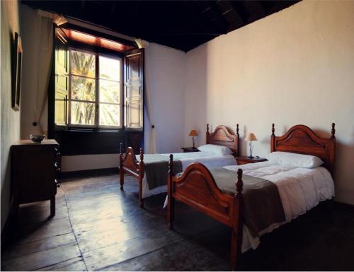 Cama o camas de una habitación en Casa Rural El Palmar