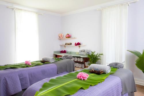 A bed or beds in a room at Splash at Coconut Bay Beach Resort and Spa