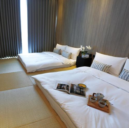A bed or beds in a room at Hotel Day Plus Teascape