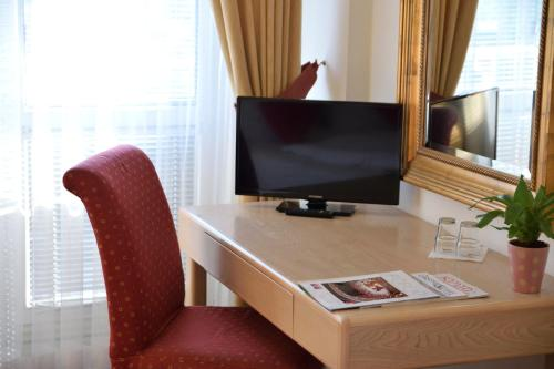 A television and/or entertainment center at OAZA hotel