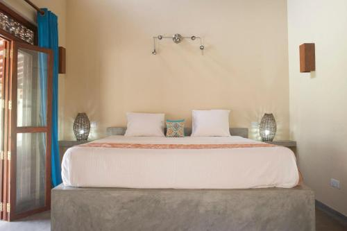 A bed or beds in a room at Wild Lotus Yala