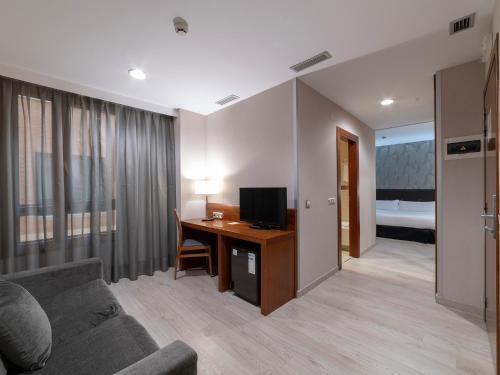 โทรทัศน์และ/หรือระบบความบันเทิงของ Hotel Plaza Las Matas
