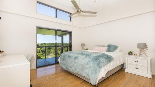 A bed or beds in a room at Timbavati - Air-conditioning - WiFi