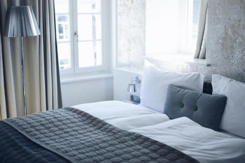 Ein Bett oder Betten in einem Zimmer der Unterkunft Hotel Rössli