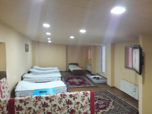 Cama ou camas em um quarto em Oskar