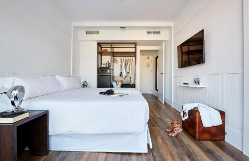 A bed or beds in a room at Delamar 4*Sup-Adults only (18+)