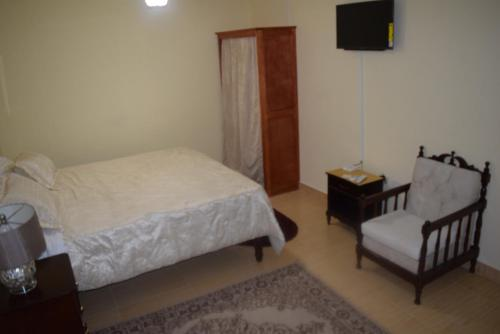 A bed or beds in a room at The One Apartments #Studio 3