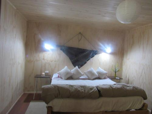 A bed or beds in a room at Centro Ecuestre Hipomedano