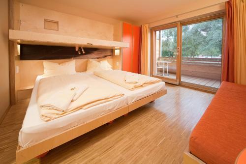 Кровать или кровати в номере JUFA Hotel Leibnitz