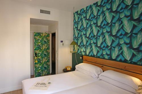 Ein Bett oder Betten in einem Zimmer der Unterkunft Chic & Basic Lemon Boutique Hotel