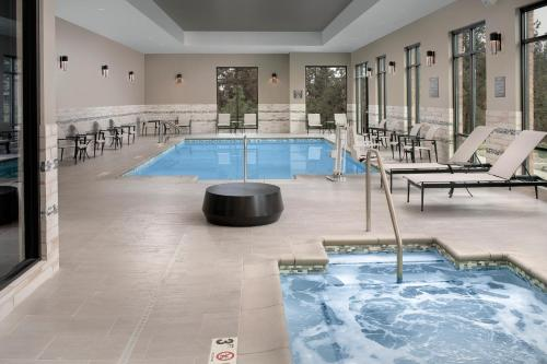 The swimming pool at or near Residence Inn By Marriott Bend
