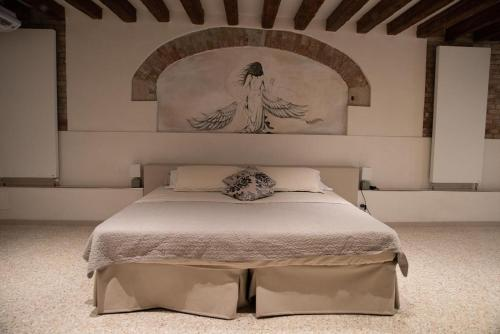 A bed or beds in a room at Casa Marco Polo