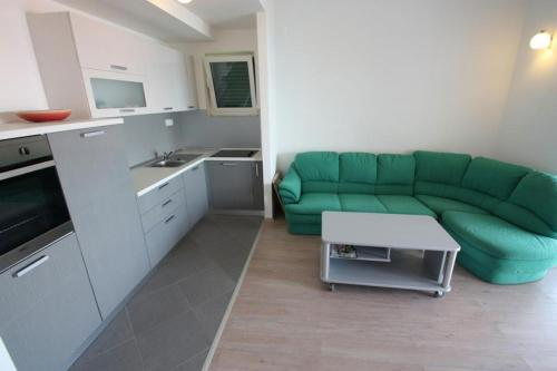 A kitchen or kitchenette at Apartments Sonne