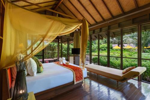 A bed or beds in a room at Zeavola Resort