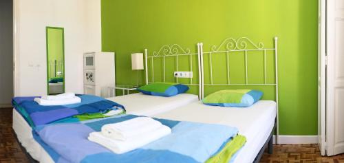 A bed or beds in a room at Leon Hostel