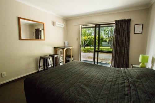A bed or beds in a room at Fiordland Great Views Holiday Park
