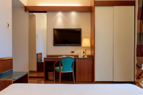 A television and/or entertainment center at Hotel Polo