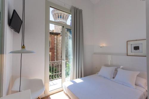 Кровать или кровати в номере Hostal Argo