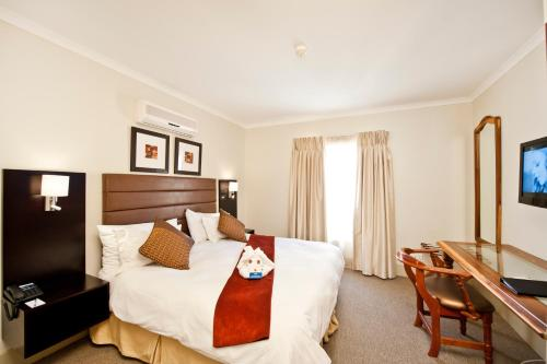 A bed or beds in a room at Protea Hotel by Marriott Walvis Bay