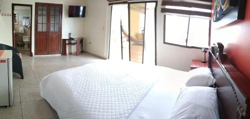 A bed or beds in a room at Casa Canelos