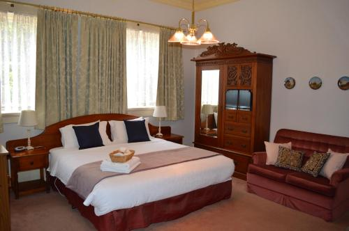A bed or beds in a room at The Dragonfly North West