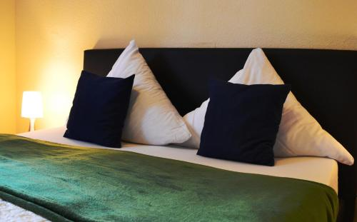 A bed or beds in a room at Hotel Athos
