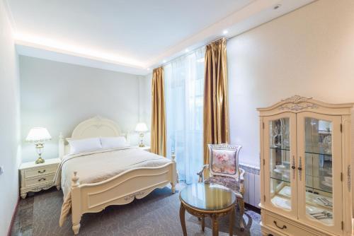 Кровать или кровати в номере Гостиница «Ленина отель»