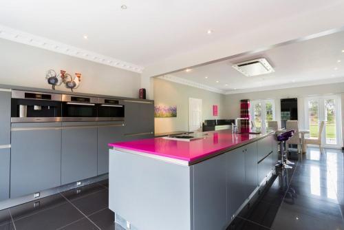 A kitchen or kitchenette at Belton Chateau Sleeps 24 Pool WiFi